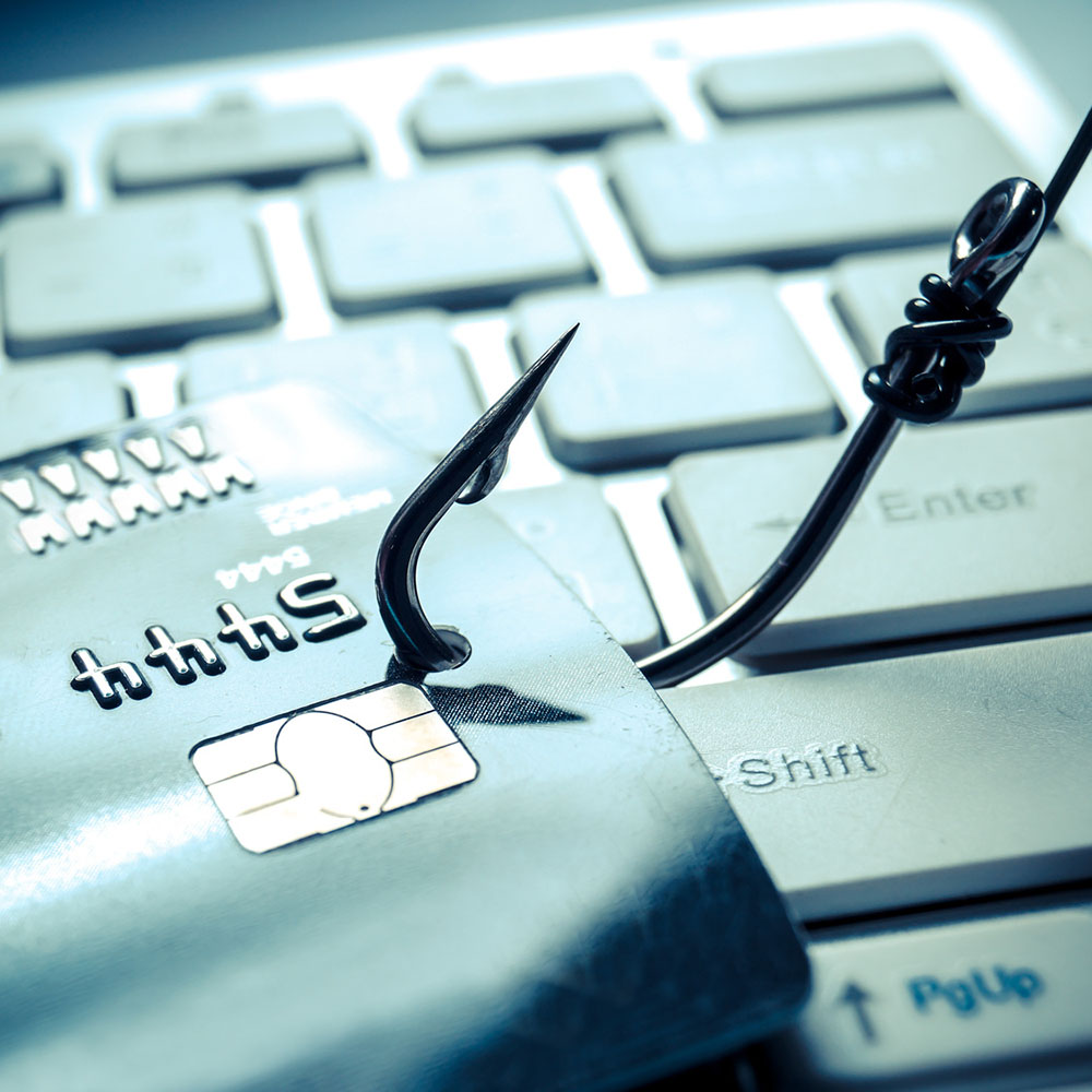 credit card phishing - piles of credit cards with a fish hook on